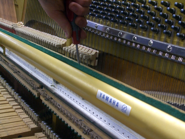 Yamaha upright piano restoration detail 1