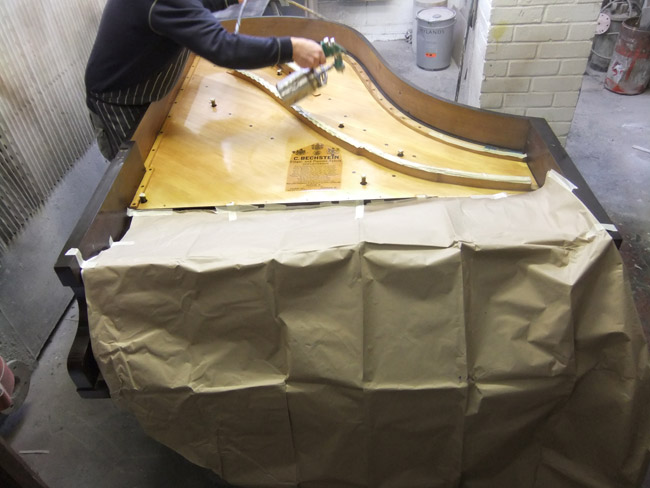 Piano Restoration - sealing and spraying the soundboard