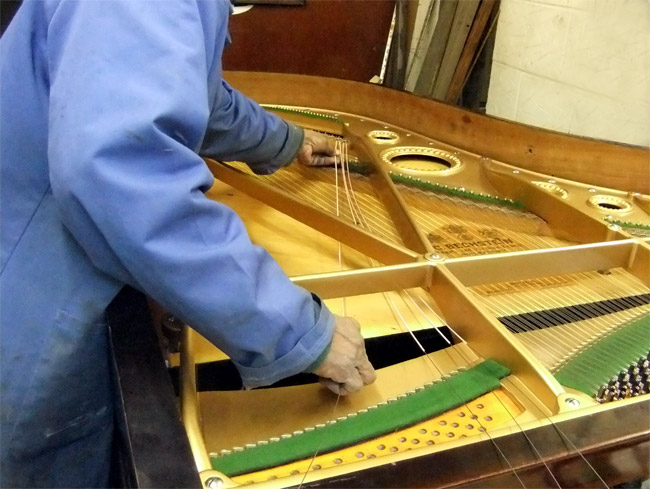 Replacing bass strings on a grand piano